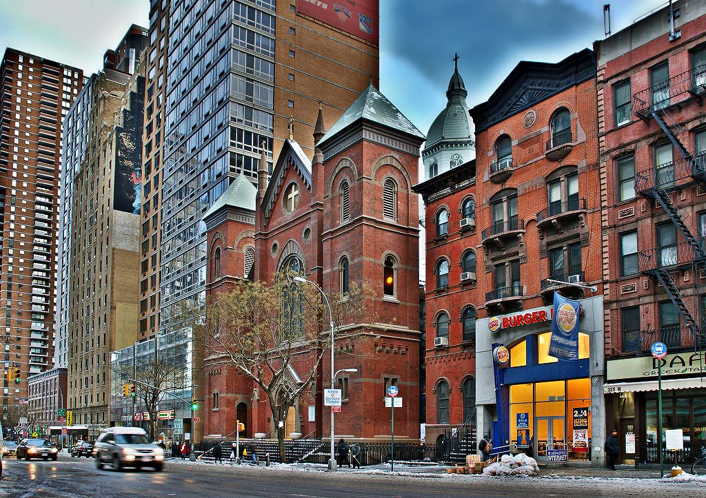 #1. The Church of the Holy Cross is lined up with high rises on West 42nd Street.